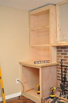 Building Built-In Cabinets and Shelves (part 2)- what I should do around my fireplace instead of the ugly drywall shelves!