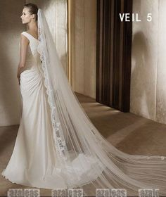 I'm liking the idea of a veil longer than my dress.  I've never wanted to haul a long train around while dancing (even pinned up they're supposed to be heavy), but this seems like a good way to get that draped effect.