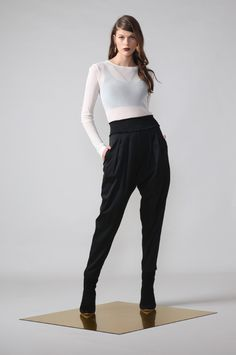 aura pant / black by Moochi. Everyday luxury, from off-duty essentials to coveted designer pieces. Buy Now! Off Duty, Winter 2017, Winter Collection, No Frills, Black Pants, Hemline, Parachute Pants, Bring It On, Legs