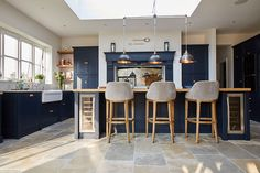 Upholstered bar stools under bespoke kitchen island by The Main Company - The Main Company Open Plan Kitchen Dining Living, Open Plan Kitchen Diner, Living Room Kitchen, Home Decor Kitchen, New Kitchen, Kitchen Design, Updated Kitchen, Kitchen Ideas, Country Kitchen Island