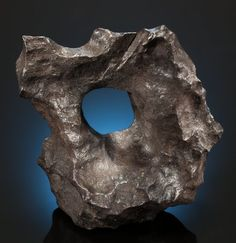 Meteorites:Irons, UNBELIEVABLE GIBEON METEORITE WITH HUGE NATURAL HOLE. Iron, fineoctahedrite - IVA . Great Nama Land, Namibia 24.77 x 20.96 x 9.53 cm (9.75 x 8.25 x 3.75 inches) and 10.23 kg (22.5 pounds).Sold for: $23,750.00 Raw Gemstones, Minerals And Gemstones, Crystals Minerals, Rocks And Minerals, Stones And Crystals, Gibeon Meteorite, Lunar Meteorite, Native American Artifacts, Ancient Mysteries