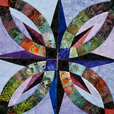 Bali Wedding Star -- This might be my favorite Wedding Ring Quilt so far ... Love the jewel tones ... I'd have to make one in all jewel tones, I think, on aqua maybe ...
