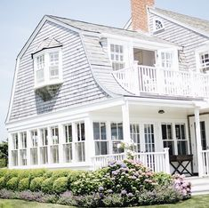 South Hampton style house with shaker siding, white picket fence, and hydrangeas in the yard. Home design decor inspiration ideas. Hamptons Style Homes, Hamptons House, Houses In The Hamptons, Coastal Cottage, Coastal Homes, Nantucket Home, Nantucket Style Homes, Shaker Siding, Gambrel Roof