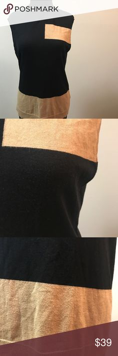 """🦋VINCE CAMUTO Sleeveless Turtle Neck Black/Tan Unique piece with color combination of black and tan giving it a sophisticated look that is a must for the season. Sleeveless Size L. Please see pictures for normal wear. Great condition! You can wear this with some spunky leather leggings add some hot booties and be start turning heads with your attire and charisma ! 🦋Armpit-Armpit: 18"""" 🦋Shoulder-Hem: 25"""". 🦋Turtle neck: 3""""   🦋🌼🌻 Vince Camuto Sweaters Cowl & Turtlenecks"""
