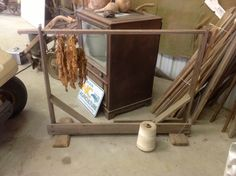 Stringing Horse with cured tobacco on a tobacco stick.  (we called it a looping horse)