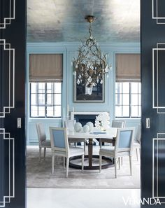 A jewel box of a dining room is splashed in robin's egg lacquer and glitters with a silver foil ceiling. - Veranda.com