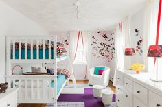 Bedroom: White Chandelier White Wooden Bed Level White Wood Stairs White Chair White Pillow Blue Mattress Foam Purple Carpet White Curtain White Glass Window Brown Wooden Floor Red Table Lamp: Creative Shared Bedroom Ideas for a Modern Kids' Room