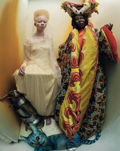 Thando Hopa and Whoopi Goldberg photographed by Tim Walker for the 'Alice in Wonderland' themed 2018 Pirelli calendar. Styled by Edward Enninful.