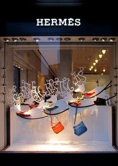 Christmas window Displays created by Senior Visual Merchandiser Kilkenny v Klimentov. Laser cut acrylic reindeers.