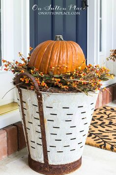 on sutton place DIY Fall Olive Bucket Pumpkin Planters http://www.onsuttonplace.com/2016/09/diy-fall-olive-bucket-pumpkin-planters/ via bHome https://bhome.us
