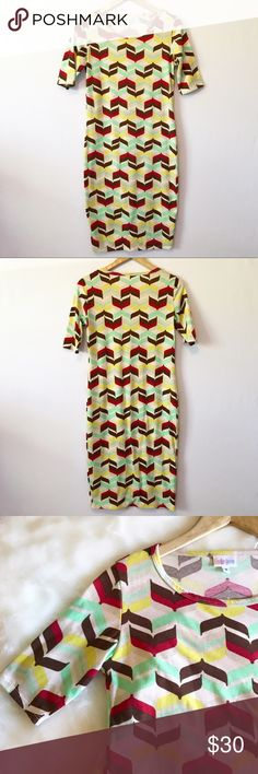 SMALL LULAROE JULIA GEOMETRIC PRINT DRESS JULIA DRESS size small . Perfect preloved condition  The Julia dress is a form fitting, knee- length, knit dress with mid-length sleeves and a high neckline. Its simple silhouette makes the Julia dress a great canvas for layering and accessorizing. This dress is a staple for every season's wardrobe. It is feminine, flattering, and you may not ever want to take it off. LuLaRoe Dresses