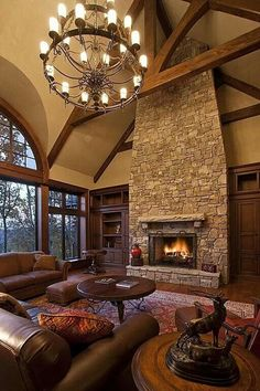Love the fireplace and high ceiling.