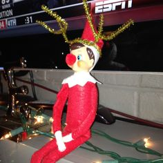 Elf on the shelf dressed as a reindeer.