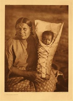 A Comanche mother. Edward Sheriff Curtis Photography.