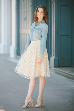 Pair a chambray shirt with a polka dots skirt.