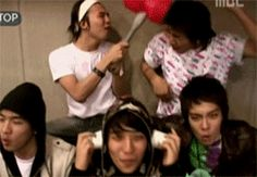 fckgdragon:  topsicecream:  the dorks are goofing around xD xD   poor daesung…look how T.O.P glanced at GD.. hehehe while the two kids, YB &...
