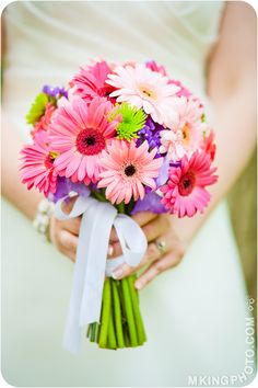 it CAN be done - homemade REAL flower bouquets!! RoseSource.com sells bulk flowers and delivers them to your home. Schedule delivery for about 5 days before your wedding so you can put them in vases to rehydrate them. The night before or morning of the wedding, bunch them as you please and tie with ribbon!