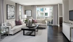 This contemporary great room in Costa Mesa, CA, features a soothing color palette   Rockefeller plan by Richmond American