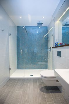 Wooden floor tiles, white wall tiles and aqua blue mosaics in this . - Wooden floor tiles, white wall tiles and aqua blue mosaics in this …, - Bathroom Renos, Bathroom Layout, Modern Bathroom Design, Bathroom Flooring, Bathroom Interior, Bathroom Ideas, Bathroom Designs, Shower Ideas, Master Bathroom
