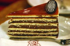 Dobos torte is a Hungarian cake featuring a five-layer sponge cake, layered with chocolate buttercream and topped with thin caramel slices.