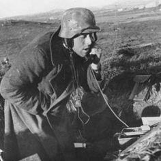 A Funker belonging to a Flakbatterie receiving fire cordinates, Italy, Nettuno Front, 1944. (Bundesarchiv Bild 146-1987-029-35)