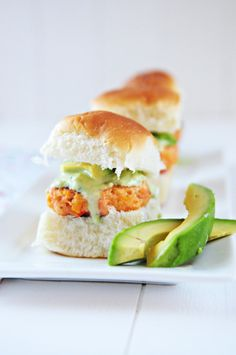 Salmon Sliders with Tangy Avocado Sauce | Everyone knows you can't have a great cookout without burgers, right? I decided to take a twist on the traditional burger and created a seafood version – Salmon Sliders with a Tangy Avocado Sauce. This is one recipe that explodes with fresh flavor and is perfect for your next gathering or for a quick, weeknight dinner. | From: dineanddish.net