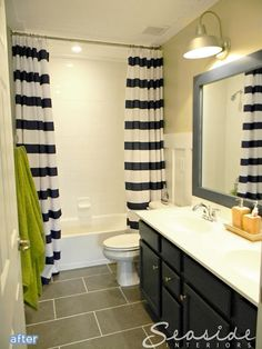 Cute bathroom makeover with double striped curtains! I want to frame my mirror a paint it one of the great colors thats in my shower curtain
