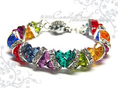 rainbow crystal bracelet Dark Rainbow Crystal Cuff Bracelet made with Swarovski crystals and silver-plated rhinestone rondelle beads. Swarovski Bracelet, Swarovski Jewelry, Crystal Bracelets, Crystal Jewelry, Beaded Jewelry, Swarovski Crystals, Jewelry Bracelets, Handmade Jewelry, Jewlery