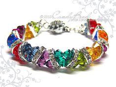 rainbow crystal bracelet Dark Rainbow Crystal Cuff Bracelet made with Swarovski crystals and silver-plated rhinestone rondelle beads. Swarovski Bracelet, Swarovski Jewelry, Crystal Bracelets, Crystal Jewelry, Wire Jewelry, Jewelry Crafts, Beaded Jewelry, Jewelry Bracelets, Handmade Jewelry