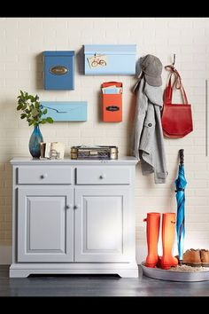 Entryway organization with mailboxes and a drip tray.