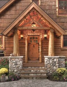 front entrance cabin. Like the steps, river rock veneer extending to foundation, posts