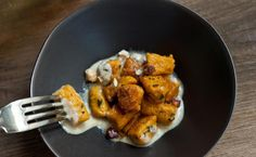 Ricotta and pumpkin gnocchi coated with a Parmesan, crème fraîche, and sage sauce, topped with hazelnuts.