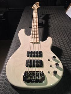G&L Musical Instruments Here's an L-2000 in Blonde over swamp ash, maple neck with Clear Satin finish, SCM wiring.