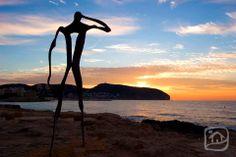 The sun shines on a new Mediterranean sunrise. Feel its heat on the Costa Blanca. Playa de l'Ampolla, Moraira