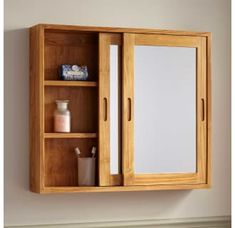 Maximize your bathroom's storage potential with the Wulan Teak Medicine Cabinet. Three rows of shelves reside behind mirrored sliding doors, allowing your belongings to be kept from view. A staple for any truly stylish home, this medicine cabinet adds Wall Cupboards, Bathroom Wall Cabinets, Mirror Cabinets, Bathroom Furniture, Bathroom Storage, Bathroom Medicine Cabinet, Small Bathroom, Medicine Cabinets, Wood Bathroom Mirror