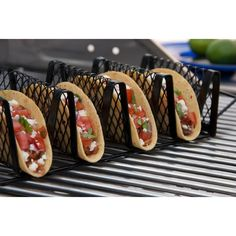 The struggle is real: how do you load up crunchy taco shells while grilling fajitas? End taco filling fumbles with this handy helper. It will open new cooking horizons for your grill.