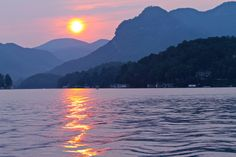 A tranquil and beautiful sunset to end the day in Lake Lure, NC. Lake Lure is a jewel of Western North Carolina. It is one of the most scenic, yet undiscovered, locations in all of North America. Lake Lure North Carolina, Asheville North Carolina, Western North Carolina, North Carolina Homes, Nc Mountains, Blue Ridge Mountains, Beautiful World, Beautiful Places, Beautiful Pictures