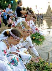 Wearing vyshyvanka dresses, Ukrainian girls float wreathes on July 6, Ivana Kupala Day.