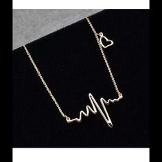 ❤️EKG and Heart Necklace❤️ New in packaging. Two available. Gold tone, gold plated. Jewelry Necklaces