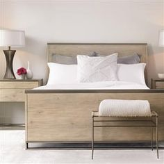 #Caracole Light: Night Cap.  Night Cap, a modern take on the sleigh bed, offers a slim profile and a pared-down sleigh form that stands straighter with a very narrow profile.