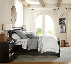Monochromatic with dark curtain rods and black and white prints. NICE! Bridge Framed Print by Michal Venera   Pottery Barn