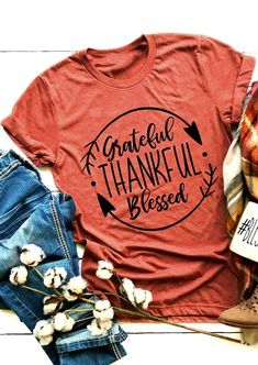 Grateful Thankful Blessed Arrow T-Shirt. This pretty t-shirt is perfect for any Thanksgiving celebration. The fabrics blend of cotton, polyester, and rayon makes this T-shirt super soft to the touch. Its softly flowing silhouette means this very feminine companion offers great comfort wherever you go. Big Discount and Limited Time ONLY! #thankful #Thanksgivingoutfits #Thanksgivingfashion #Thanksgivingtshirts #Thanksgivingtee #womensfashion #womenstops