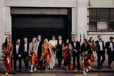 Brya and Ruperts Urban City Wedding Bridal Party wears autumnal oranges, contrasted by white heels and dried florals by Wedding Story, Wedding Book, Bridal Party Poses, British Wedding, Destination Wedding Photographer, Timeless Fashion, Wedding Photos, Wedding Ideas, Wedding Photography