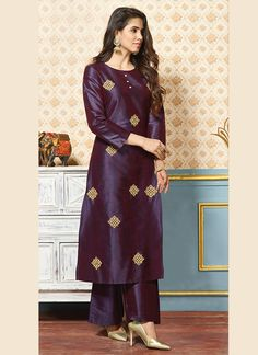 Dazzle everyone around as you walk into a wedding wearing this Violet Silk Trouser Suit which makes it astonishingly charming. This Round neck and Quarter Sleeves garment embellished in zari and stone work. Silk Kurti Designs, Salwar Designs, Kurta Designs Women, Kurti Designs Party Wear, Indian Fashion Dresses, Dress Indian Style, Indian Gowns Dresses, Stylish Dress Designs, Designs For Dresses