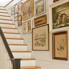 Stairs - Farmhouse Restoration Idea House Tour - Southern Living rn the stairwell into a gallery. Start by hanging two or three larger pieces along the wall, and then fill in with smaller ones. Mix the subject matter and frame styles for more interest. Wood Plank Walls, Stair Walls, Wood Planks, Stair Paneling, Planked Walls, Basement Stair, Wooden Walls, Stair Gallery, Gallery Walls