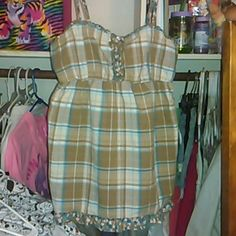 Brown checkered gathered tank top with ruffles There are five buttons at the breast area they come and buttons this is an absolutely adorable tank top on SO Tops Tank Tops