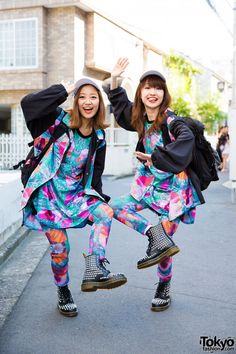 Meet Hyper Yukarin and Hyper Chan 3, singlers/rappers of the Hyper Yo-Yo spinners band. Both of them are wearing twin ensembles which consisted of a matching set of oversized shirt, pants and jacket in a colorful digital print from Plastic Tokyo. Both had on Dr. Martens studded boots as well as black backpacks from fashion brand X-Girl and white caps from KaneZ. Accessories include studded leather bracelets and gold rings. Tokyo Fashion, Japanese Street Fashion, Harajuku Fashion, Korean Fashion, Weird Fashion, Matches Fashion, Colorful Fashion, Harajuku Mode, Harajuku Girls