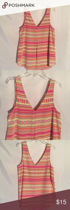 Everly pink sleeveless top shirt size S Everly pink sleeveless top shirt size S. 100% Polyester. Everly Tops Blouses