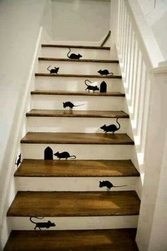 Couldn't help myself!  Looking for staircase ideas for a tight place for the kids house.  This won't work but had to laugh because they have a big mouse problem and they act like these cute little painted on mice!