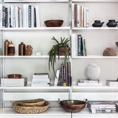 What a well styled shelf. Can you spot our Mini Bulb Basket, adding a touch of texture to this neutral space? // More on ARTHA Collections Contemporary Home Decor, Accent Decor, Baskets, Bookcase, Neutral, Bulb, Shelves, Touch, Traditional